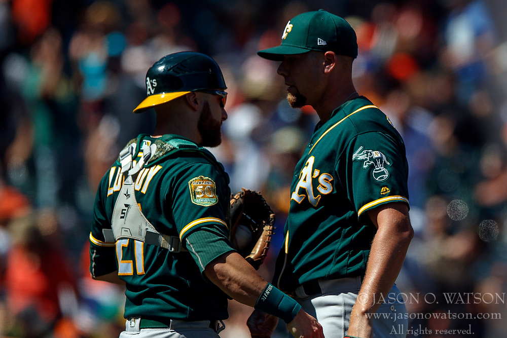SAN FRANCISCO, CA - JULY 15: Blake Treinen #39 of the Oakland Athletics celebrates with Jonathan Lucroy #21 after the game against the San Francisco Giants at AT&T Park on July 15, 2018 in San Francisco, California. The Oakland Athletics defeated the San Francisco Giants 6-2. (Photo by Jason O. Watson/Getty Images) *** Local Caption *** Blake Treinen; Jonathan Lucroy