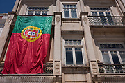 Days after Portugals historic football victory over France in the final of Euro 2016, the Portuguese national flag still hangs from an apartment balcony, on 16th July, at Alcobaca, Portugal.
