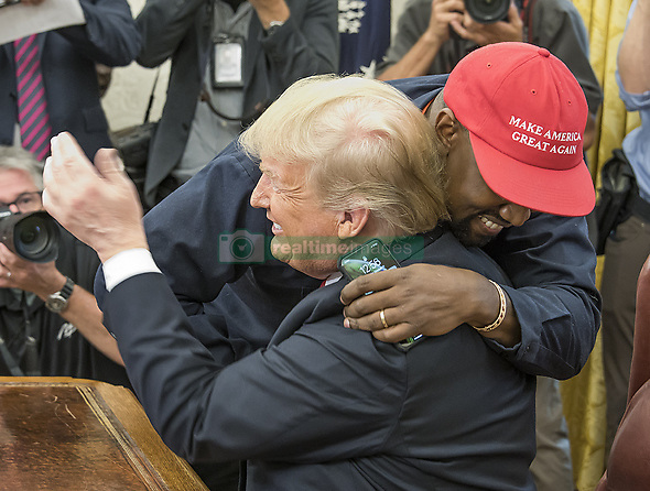 October 11, 2018 - Washington, District of Columbia, U.S. - KANYE WEST hugs United States President DONALD J. TRUMP as they meet in the Oval Office of the White House. (Credit Image: © Ron Sachs/CNP via ZUMA Wire)