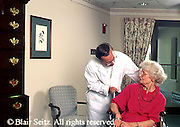 Active Aging Senior Citizens, Retired, Activities, Elderly Woman in Wheelchair, Male Helps, Assisted Care