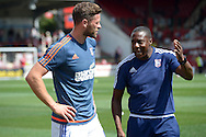 Terry Connor, the Ipswich Town assistant manager (r) gives instructions to Daryl Murphy of Ipswich Town during pre-match warm up. Skybet football league Championship match, Brentford v Ipswich Town at Griffin Park in London on Saturday 8th August 2015.<br /> pic by John Patrick Fletcher, Andrew Orchard sports photography.