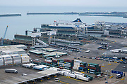 Lorries and shipping containers inside the Eastern Dock of the Port of Dover is where the cross channel port is situated with ferries departing here to go to Calais in France. Dover, Kent, United Kingdom.  Dover is the nearest port to France with just 34 kilometres 21 miles between them. It is one of the busiest ports in the world. As well as freight container ships it is also the main port for P&O and DFDS Seaways ferries.