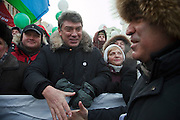 Moscow, Russia, 04/02/2012..Opposition politician Boris Nemtsov greets former world chess champion Gary Kasparov, as tens of thousands of demonstrators march in central Moscow and protest against election fraud and Prime Minister Vladimir Putin in temperatures of -20 centigrade. Organisers claimed an attendance of 130,000 despite the bitter cold.
