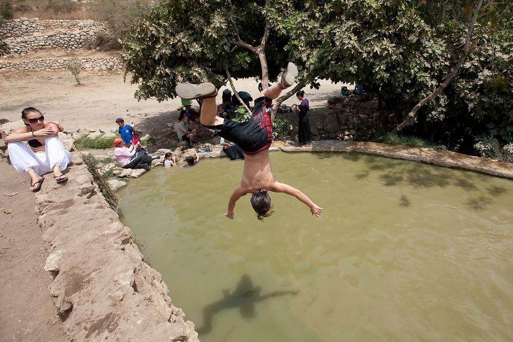 Israelis enjoy the cool water of one of the pools at Ein Lavan, during a heat wave, on August 1, 2010. Ein Lavan is a spring in the Nahal Refaim National Park in Jerusalem.