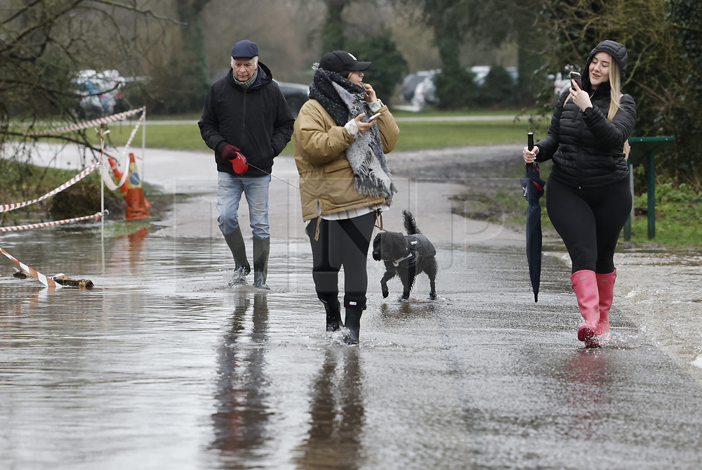 © Licensed to London News Pictures. 30/01/2021. Rickmansworth, UK. People make their way through rising floodwater at a nature reserve in Rickmansworth. Days of heavy rain have lead to flood warnings for some areas in the south. Snow flurries are expected as far south as London this weekend. Photo credit: Peter Macdiarmid/LNP