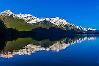 Reflections of mountain peaks in Chilkoot Lake, Haines, Alaska USA.