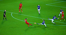 LIVERPOOL, ENGLAND - Monday, December 19, 2016: Liverpool's Georginio Wijnaldum  has a shot against Everton as James McCarthy and Ramiro Funes Mori try to block during the FA Premier League match, the 227th Merseyside Derby, at Goodison Park. (Pic by Gavin Trafford/Propaganda)