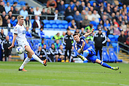 Anthony Pilkington of Cardiff city ® goes close to scoring from long range but shoots just wide of goal. .Skybet football league championship match, Cardiff city v Bolton Wanderers at the Cardiff city Stadium in Cardiff, South Wales on Saturday 23rd April 2016.<br /> pic by Andrew Orchard, Andrew Orchard sports photography.