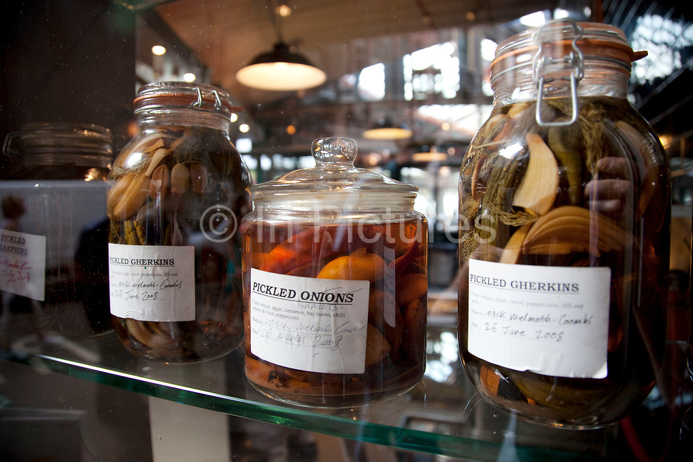 Pickle jars at a fish shop. Borough Market is a thriving Farmers market near London Bridge. Saturday is the busiest day.
