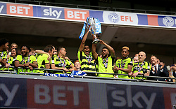 Huddersfield Town's Collin Quaner (left) and Elias Kachunga (right) lift the trophy after their side win the Sky Bet Championship Play Off Final
