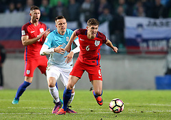 John Stones of England goes past Josip Illicic of Slovenia - Mandatory by-line: Robbie Stephenson/JMP - 11/10/2016 - FOOTBALL - RSC Stozice - Ljubljana, England - Slovenia v England - World Cup European Qualifier