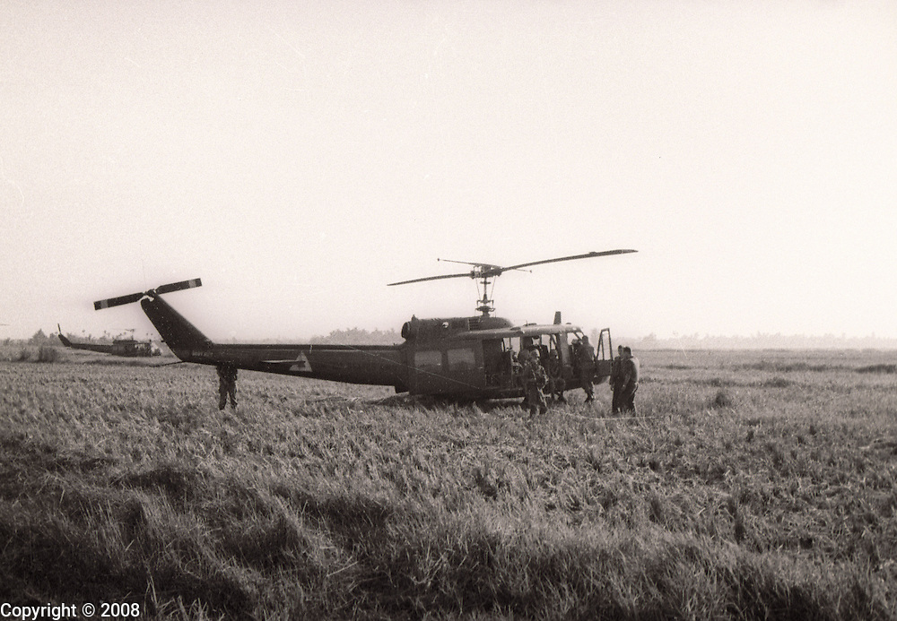 """An Huey helicopters of the 121st AHC out of Soc Trang, Vietnam, waits for a mission during the Vietnam War. The photo was made in 1966 or 1967. The army helicopter unit is often referred to as the, """"Soc Trang Tigers."""""""