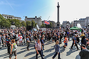 "Thousands gathered in London's Trafalgar Square from across the UK in London on Saturday, Sept 19, 2020 - to protest against coronavirus restrictions and reject mass vaccinations. The event, which began at noon, drew a broad coalition including coronavirus sceptics, 5G conspiracy theorists and so-called ""anti-vaxxers"". Speakers at the event accused the government of attempting to curtail civil liberties. (VXP Photo/ Vudi Xhymshiti)"