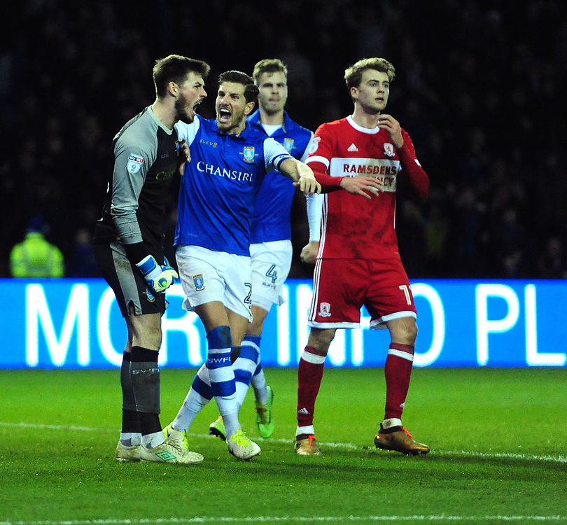 Sheffield Wednesday's Joe Wildsmith, left, is congratulated on saving a penalty taken by Middlesbrough's Grant Leadbitter by his team-mate Sam Hutchinson<br /> <br /> Photographer Chris Vaughan/CameraSport<br /> <br /> The EFL Sky Bet Championship - Sheffield Wednesday v Middlesbrough - Saturday 23rd December 2017 - Hillsborough - Sheffield<br /> <br /> World Copyright © 2017 CameraSport. All rights reserved. 43 Linden Ave. Countesthorpe. Leicester. England. LE8 5PG - Tel: +44 (0) 116 277 4147 - admin@camerasport.com - www.camerasport.com