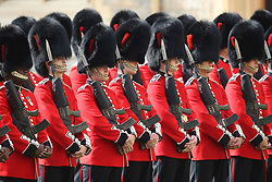 Soldiers from the Coldstream Guards await the arrival of US President Donald Trump at Windsor Castle, Windsor.