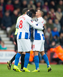 Brighton & Hove Albion's Yves Bissouma celebrates his goal and has his head kissed by fellow goalscorer Anthony Knockaert