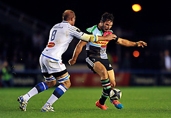 George Lowe of Harlequins puts in a grubber kick - Photo mandatory by-line: Patrick Khachfe/JMP - Mobile: 07966 386802 17/10/2014 - SPORT - RUGBY UNION - London - Twickenham Stoop - Harlequins v Castres Olympique - European Rugby Champions Cup