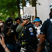 A police supervisors deescalates the situation and pulls his officers back from the crowd. Black Lives Matter protesters confronted the police shadowing them as they march towards the capitol. Some felt they were threating the group.