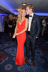 KIMBERLEY GARNER and CAMERON JOHNSON at the Chain of Hope Ball held in aid of the charity Chain of Hope, founded by Professor Sir Magdi Yacoub which organises volunteer teams worldwide to operate on children suffering from life-threatening heart diseases, held at the Grosvenor House Hotel, Park Lane, London on 20th November 2015.