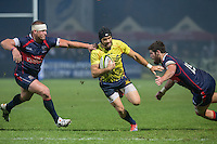 Nicholas Wallace (L) and Gregory Peterson (R) of USA tries to stop Dorin Manole (C) of Romania during their  rugby test match between Romania and USA, on National Stadium Arc de Triomphe in Bucharest, November 8, 2014.  Romania lose the match against USA, final score 17-27.