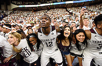 Texas A&M's Jalen Jones (12) sings the Aggie War Hym with Texas A&M students after a win over Kentucky in an NCAA college basketball game, Saturday, Feb. 20, 2016, in College Station, Texas. Texas A&M won 79-77. (AP Photo/Sam Craft)