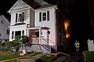 Middletown, New York - Firefighters work at the scene of a fire on Commonwealth Avenue on July 2, 2012. The fire started at about 3:30 a.m.