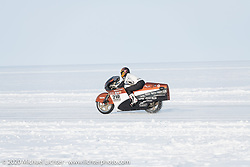 Team mechanic-tuner Simon Pitelet taking a pass on the mile long course on custom bike builder Bertrand Dubet's partially streamlined Aprilia RSV4 racer during the Baikal Mile Ice Speed Festival. Maksimiha, Siberia, Russia. Saturday, February 29, 2020. Photography ©2020 Michael Lichter.