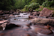 Long exposure shot of a river near the Talybont reservoir, south of Brecon, in Powys, Wales. This is a 25 second exposure.