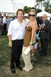 CAPRICE BOURRET and JOHN HITCHCOX at the Cartier International Polo at Guards Polo Club, Windsor Great Park on 27th July 2008.<br /> <br /> NON EXCLUSIVE - WORLD RIGHTS