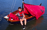 AT5BYE Young boy with his Mirror dinghy sailing boat