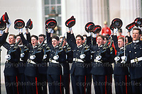 April 1991. Officer cadets celebrating their 'passing out' parade at Sandhurst,from the stroke of midnight they will become fully commissioned officers in the British Army.Photographed by Terry Fincher