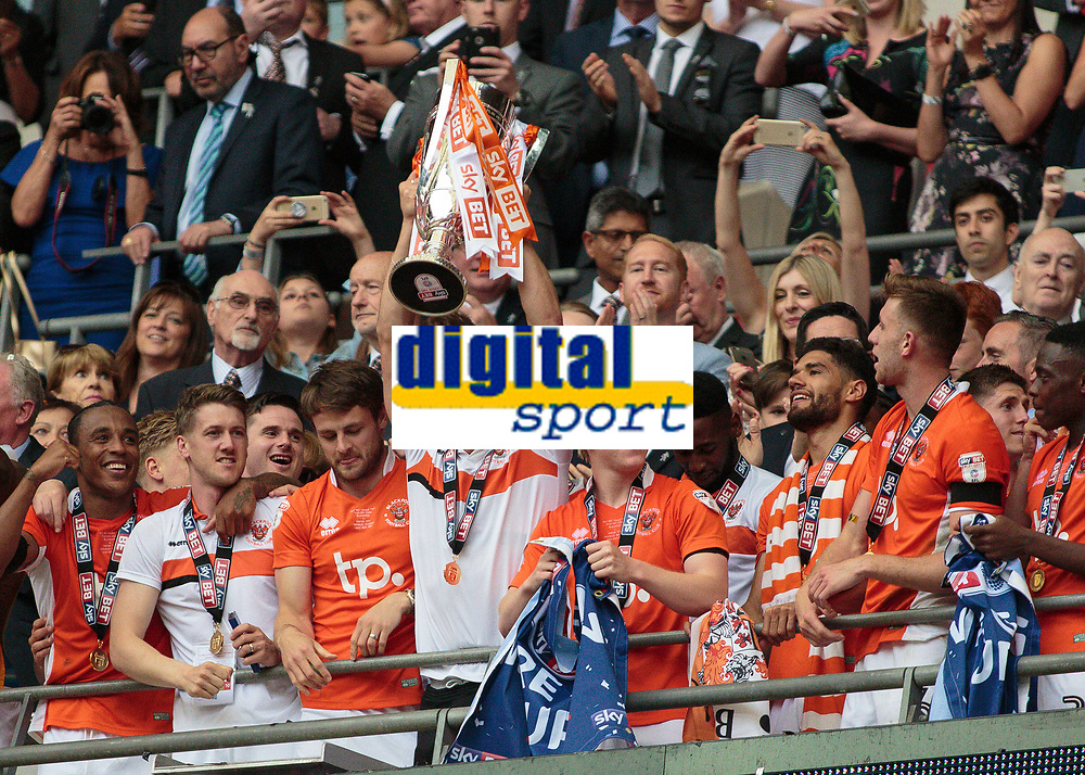 Football - 2017 Sky Bet [EFL] League Two Play-Off Final - Blackpool vs. Exeter City<br /> <br /> Tom Aldred of Blackpool  lifts the Play Off at Wembley.<br /> <br /> COLORSPORT/DANIEL BEARHAM