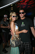 18th April 2009. Indio, California. Paris Hilton and her boyfriend Doug Reinhardt, in the VIP area, at the Coachella Music Festival..PHOTO © JOHN CHAPPLE / REBEL IMAGES.tel +1 310 570 9100    john@chapple.biz