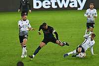 Football - 2020 / 2021 Emirates FA Cup - Round Five - Swansea City vs Manchester City - Liberty Stadium<br /> <br /> Kyle Walker OF Manchester City tackled by Paul Arriola OF Swansea City