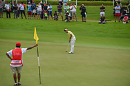 Takumi KANAYA (JPN) watches his putt on 18 during Rd 4 of the Asia-Pacific Amateur Championship, Sentosa Golf Club, Singapore. 10/7/2018.<br /> Picture: Golffile | Ken Murray<br /> <br /> <br /> All photo usage must carry mandatory copyright credit (© Golffile | Ken Murray)