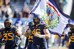 Nov 10, 2018; Morgantown, WV, USA; West Virginia Mountaineers defensive lineman Reese Donahue (46) runs onto the field before their game against the TCU Horned Frogs at Mountaineer Field at Milan Puskar Stadium. Mandatory Credit: Ben Queen-USA TODAY Sports