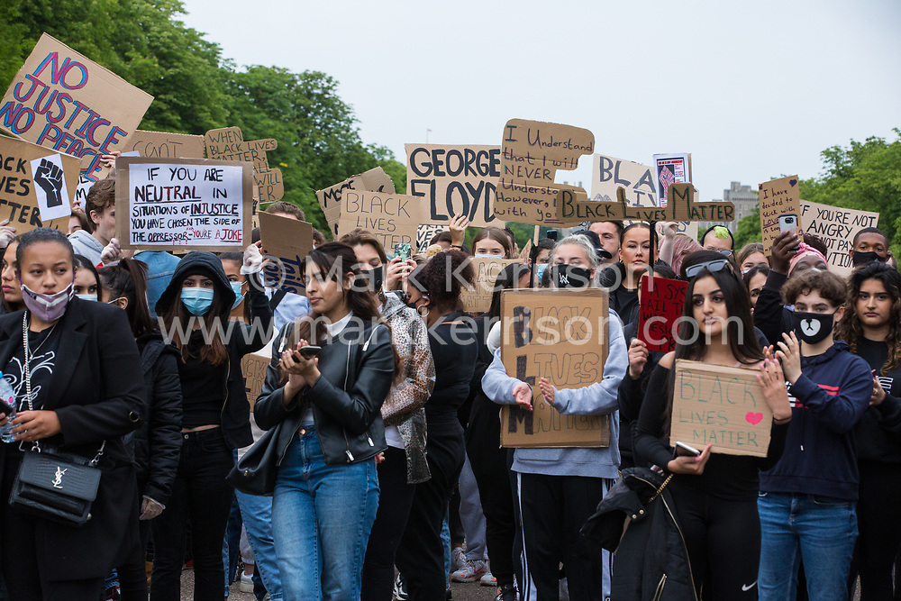 Windsor, UK. 4 June, 2020.  Hundreds of young people take part in a peaceful protest march along the Long Walk in front of Windsor Castle in solidarity with the Black Lives Matter movement. The march was organised at short notice by Jessica Christie at the request of her daughter Yani, aged 12, following the death of George Floyd while in the custody of police officers in Minneapolis in the United States.