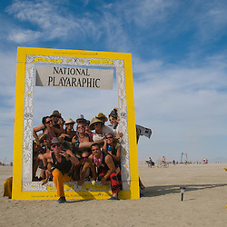 Aug. 29 2008 - Black Rock City, Nevada, USA - Festival goers pose for pictures in an art installation parodying National Geographic Magazine, Friday, Aug. 29, 2008 during the Burning Man arts and culture festival in Black Rock City in the Black Rock Desert near Gerlach, Nev. (Credit Image: © David Calvert/ZUMA Press)