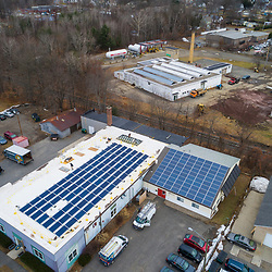 Solar panels on the roof of a commercial building in Greenfield, Massachusetts.