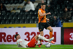 Hull City's Callum Elder battles with Blackpool's Gary Madine during the Sky Bet Championship match at the MKM Stadium, Hull. Picture date: Tuesday September 28, 2021.