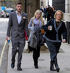 © Licensed to London News Pictures.05/04/2017.London, UK. CHRIS GARD (L) and CONNIE YATES (C) arrive at The Royal Courts of Justice in London where a High Court judge is due to rule on whether doctors can withdraw life-support treatment to their son, Charlie, who suffers from a rare genetic condition. Doctors at Great Ormond Street Hospital in London say eight-month-old Charlie should be left to die in dignity, but his parents have raised £1.2 million for specialist treatment in America.Photo credit: Ben Cawthra/LNP