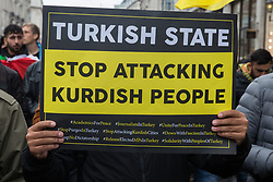 London, UK. 13 October, 2019. Kurdish supporters of the YPG march in protest against Turkey's invasion of Kurdish-held territory in north-eastern Syria.
