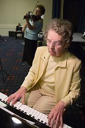 Elderly woman playing piano,