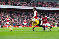 Watford's Roberto Pereyra goes down under the challenge of Arsenal's Ainsley Maitland-Niles to win a penalty <br /> <br /> Photographer Craig Mercer/CameraSport<br /> <br /> The Premier League - Sunday 11th March 2018 - Arsenal v Watford - The Emirates - London<br /> <br /> World Copyright © 2018 CameraSport. All rights reserved. 43 Linden Ave. Countesthorpe. Leicester. England. LE8 5PG - Tel: +44 (0) 116 277 4147 - admin@camerasport.com - www.camerasport.com
