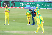Cricket - 2019 ICC Cricket World Cup warm ups - Australia vs. Sri Lanka<br /> <br /> Usman Khawaja of Australia looks at his leg after injuring himself whilst fielding during the cricket world cup warm up match at the Hampshire Bowl Southampton England<br /> <br /> COLORSPORT/SHAUN BOGGUST