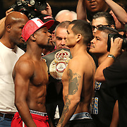 """Floyd Mayweather Jr. (left) faces off with Marcos Maidana during the official weigh-ins for the Mayweather versus Maidana boxing match slated as """"The Moment"""", at the MGM Grand hotel on Friday, May 2, 2014 in Las Vegas, Nevada.  (AP Photo/Alex Menendez)"""