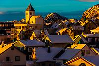 Early morning light on snow covered rooftops in Svolvaer, Austvagoya Island, Lofoten Islands, Arctic, Northern Norway.