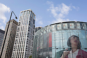 A large image of a woman appearing in an ad appears on the circular structure of the IMAX cinema at Waterloo, on 15th August 2019, in London, England.