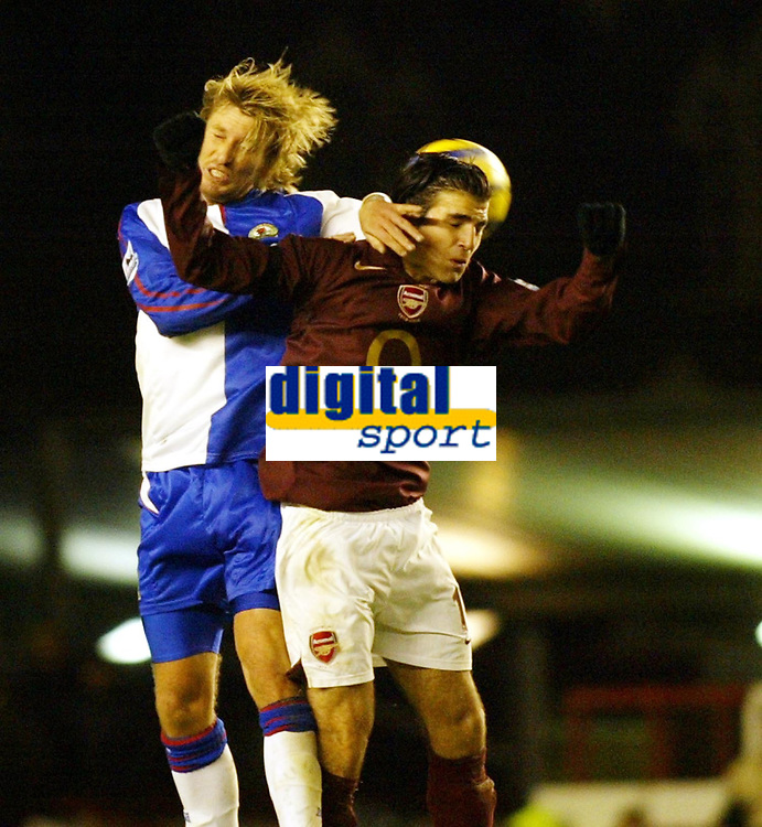 Photo: Chris Ratcliffe.<br />Arsenal v Blackburn Rovers. The Barclays Premiership.<br />26/11/2005.<br />Robbie Savage (L) and Cesc Fabregas contest an aerial ball