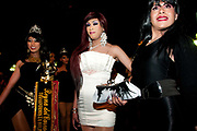 Pride, La Paz ,Bolivia. June 29th 2013. Three transvestites pose for the camera, one with a sash saying, Queen of the Carnival, transformist/transgender Bolivia.